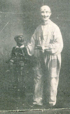 "Charles McCarty as Clown with ""Danny"" his black ventriloquist"